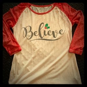 Christmas shirt with the word Believe on it